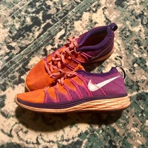 Women's 7 orange Nike running shoes